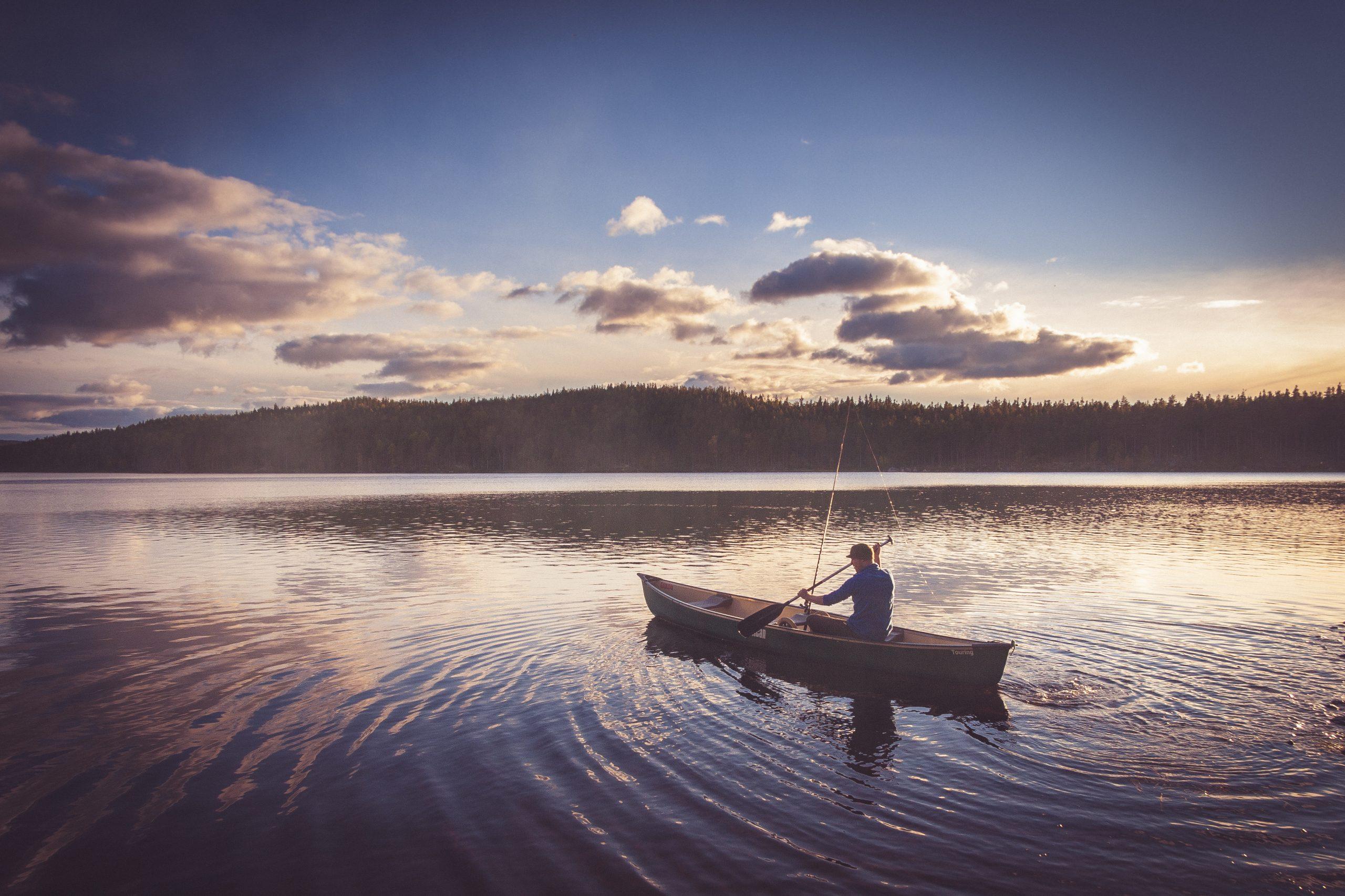 canoeing across a lake